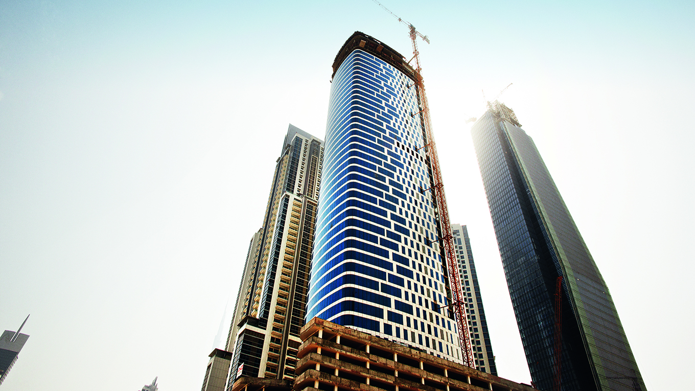 55-storey office tower with complex curved roof structure.