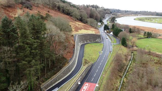 Carillion. Project aerial photo showing A487 at Glandyfi where the retained cutting enables a private means of access to the residential properites. (Use of image courtesy of Carillion)