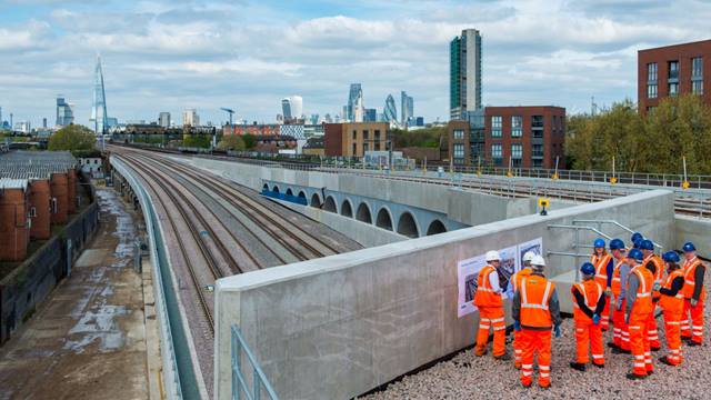 ICE London. April 2017 award judges viewing the series of new structures constructed along the line of existing operational railway viaducts at the Bermondsey Dive Under. Wherever possible, existing structures were reused to reduce disruption and waste.