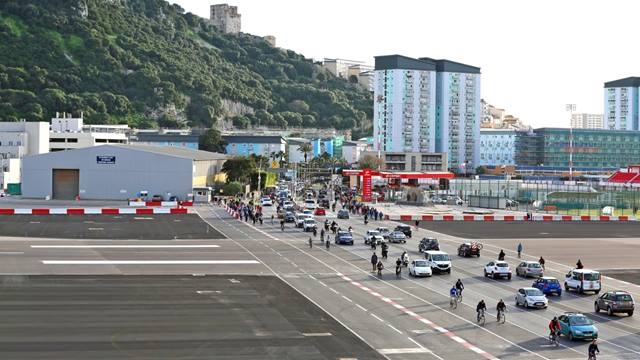 RAF Command Photographer. Winston Churchill Avenue, one of Gibraltar's busiest roads, cuts directly across the runway. Airfield barriers restrict vehicle, cycle and pedestrian movements every time a plane lands or departs.