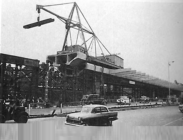 Institution of Civil Engineers - proceedings Dec 1962. Construction in 1960. Beam segment being lowered into position [Paper No.6633, by Rawlinson and Stott]
