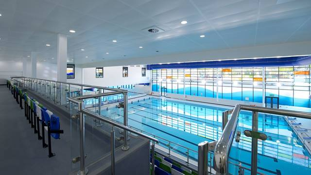 Ramboll. Oldham Leisure Centre. 8 Lane 25m county level standard swimming pool and viewing gallery. Image: Courtesy of Willmott Dixon. Photographer: Christian Smith