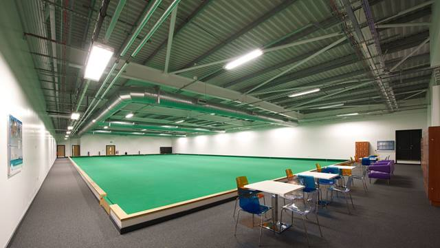 Ramboll. Oldham Leisure Centre, indoor bowls hall. Image: Courtesy of Willmott Dixon. Photographer: Christian Smith